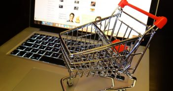 Small shoping cart on laptop computer
